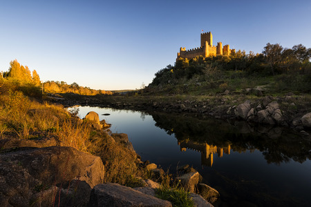 templars: View of the Almourol Castle, in the Tagus River, Portugal. The Almoroul Castle was conquered by the first Portuguese King, D. Afonso Henriques, in 1129 and delivered to the Templar Order. The castle is built in a bank in the Tagus River in the Santarm Dis