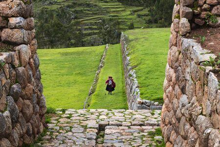 inca ruins: Chinchero, Peru - December 23, 2013: A Peruvian woman in the Inca Ruins in the village of Chinchero, in Peru.