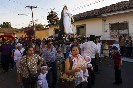 procession: Leon, Nicaragua - April 14, 2014: People in a procession in the streets of the city of Leon in Nicaragua during the Easter celebrations Editorial