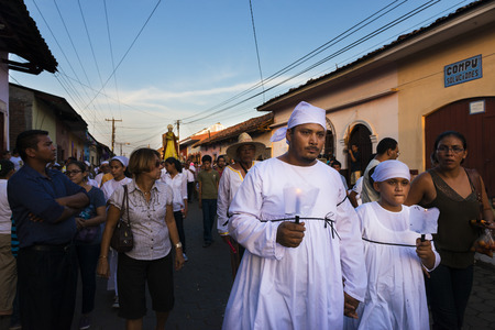 Leon, Nicaragua - April 14, 2014: People in a procession in the streets of the city of Leon in Nicaragua during the Easter celebrations Editorial