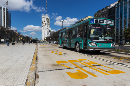 evita: Buenos Aires, Argentina - October 4, 2013: A public bus at the 9 de Julio Avenue in Buenos Aires, Argentina.