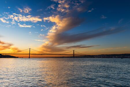 the tagus: View of the bridge over the Tagus River in Lisbon, Portugal, at sunset