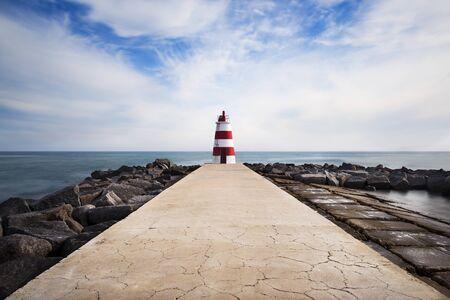 rocha: The pier in the beach Rocha in Portimao, Algarve, Portugal