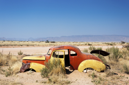 rusty car: An old rusty car in Solitaire, Namibia