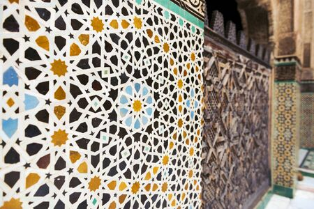 made in morocco: Detail of a wall ornamented with tiles in the Madrasa Bou Inania, in Fez, Morocco