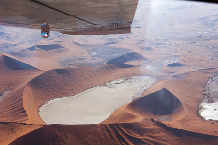 vlei: Flying over the Dead Vlei, Sossusvlei, in Namibia; Aerial view of the Dead Vlei, Concept for traveling in Africa