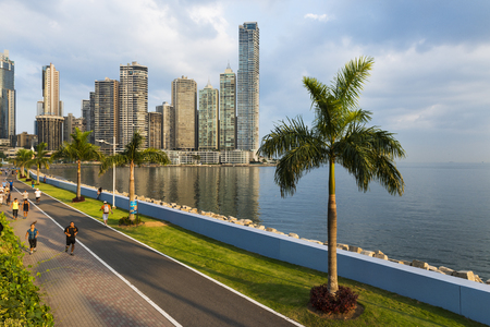 panama city: Panama City, Panama - March 18, 2014: People jogging in a sidewalk near the Panama City Finantial District, in Panama Editorial