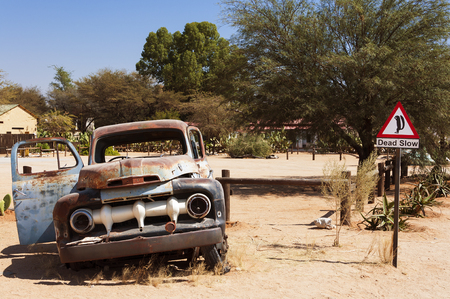 old sign: Old rusty car and road sign in Solitaire, Namibia