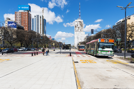 Buenos Aires, Argentina - October 4, 2013: View of the Avenida 9 de Julio in the city of Buenos Aires, with buses and people in the street.
