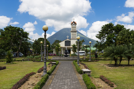 La Fortuna, Costa Rica - March 31, 2014: View of the town of La Fortuna in Costa Rica with the Arenal Volcano on the back.