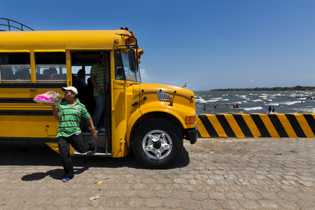 San Jorge, Nicaragua - April 11, 2014: Food vendor leaving a bus in the Ferry Terminal in the town of San Jorge in the shores of the Lake Nicaragua, Nicaragua Editorial
