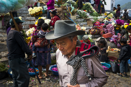 local 27: Chichicastenango, Guatemala - April 27, 2014: Local people in a street market in the town of Chichicastenango, in Guatemala Editorial