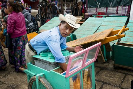 cristobal: San Cristobal de Las Casas, Mexico - May 10, 2014: A man selling Ice Creams in a street market in the city of San Cristobal de Las Casas in the Chiapas region, Mexico.