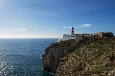 cosa: View of the Lighthouse at the Saint Vincent Cape (Cabo de Sao Vincente) in Sagres, Algarve, Portugal; Concept for travel in Portugal Stock Photo