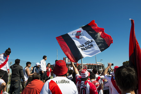 Buenos Aires, Argentina - October 6, 2013: River Plate supporters sing and dance while waiting for the stadium doors to open to attend a soccer game at the Estadio Monumental Antonio Vespucio Liberti in the city of Buenos Aires, Argentina