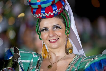 Lisbon, Portugal - June 12, 2014: Smiling woman at the parade of popular marches (Marchas Populares) along the Liberdade Avenue (Avenida da Liberdade) in Lisbon, Portugal