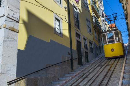 bica: Yellow Bica Elevator (Elevador da Bica) in the historic neighborhood of Bica in Lisbon, Portugal; Concept for travel in Lisbon