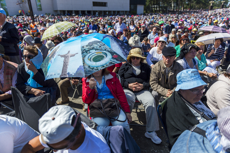 catholic nuns: Fatima, Portugal - May 13, 2014: Crowd of people at the Sanctuary of Fatima during the celebrations of the apparition of the Virgin Mary in Fatima, Portugal. Editorial