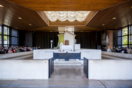 catholic nuns: Fatima, Portugal - May 13, 2014: Pilgrims at the Chapel of the Apparitions at the Sanctuary of Fatima during the celebrations of the apparition of the Virgin Mary in Fatima, Portugal.