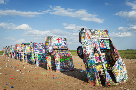 Amarillo, Texas - July 8, 2014: Row of brightly painted Cadillacs in the Cadillac Ranch in Amarillo, Texas, USA.