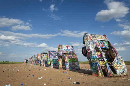 Amarillo, Texas - July 8, 2014: Row of brightly painted Cadillacs in the Cadillac Ranch in Amarillo, Texas, USA. Stok Fotoğraf - 78038247