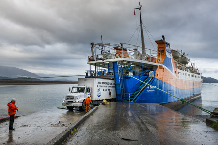 Chaitén, Chile - November 8, 2013: Truck entering in a Ferry Boat in the town of Chaitén, in Chile, South America