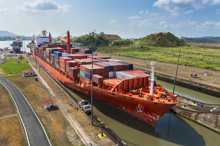 Panama Canal, Panama - March 17, 2014: Cargo Ship entering the Miraflores Lacks in the Panama Canal in Panama