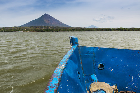 americal: Deteail of the bow of a ferry boat with the Ometepe Island on the background, in Nicaragua; Concept for travel in Nicaragua and Central America Stock Photo