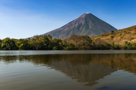 americal: View of the Concepcion Volcano and its reflection on the water in the Ometepe Island, Nicaragua; Concept for travel in Nicaragua and Central America