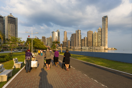 Panama City, Panama - March 18, 2014: View of the downtown of the City of Panama with people walking in a promenade and modern buildings on the background.