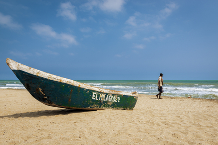 Palomino, Colombia - March 13, 2014: Man walking in the Palomino Beach in the Caribbean Coast of Colombia, South America