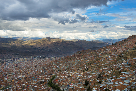 The city of La Paz seen from El Alto and the surrounding mountains on the background, in Bolivia, South America