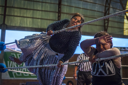 El Alto, Bolivia - December 8, 2013: Cholita wrestlers during a wrestling fight in the city of El Alto, Bolivia. The Fighting Cholitas are a group of female wrestlers.