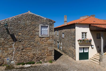 Two traditional colorful houses in the historic village of Castelo Mendo, in Portugal; Concept for travel in Portugal