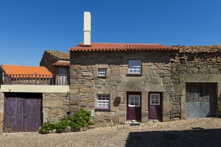 Traditional house made of stone in the historic village of Castelo Mendo, in Portugal; Concept for travel in Portugal Stock Photo