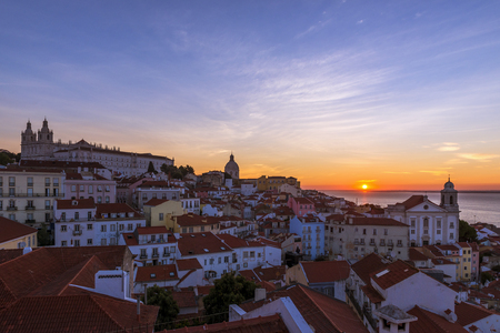 View of the Alfama neighborhood from the Portas do Sol viewpoint at sunrise in Lisbon, Portugal; Concept for travel in Portugal Stok Fotoğraf