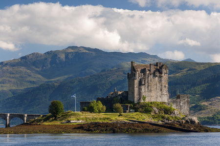 View of the Eilean Donan Castle in the Highlands of Scotland, United Kingdom; Concept for travel in Scotland Editorial