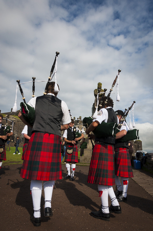 scottish culture: Stirling, Scotland - August 17, 2010: Band of pipers playing at the Stirling Castle in Stirling, Scotland, United Kingdom