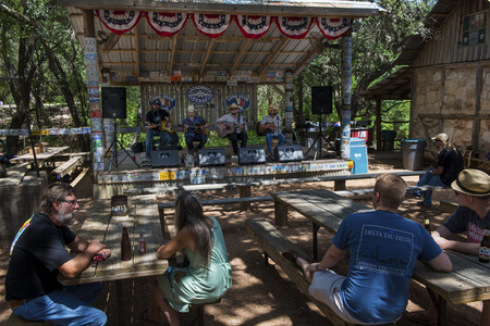 Luckenbach, Texas - June 8, 2014: People attending a country music concert in Luckenbach, Texas, USA.