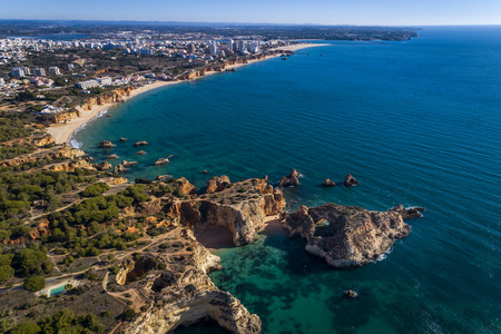 Aerial view of the coastline with beautiful beaches along the city of Portimao in Algarve, Portugal Stock Photo