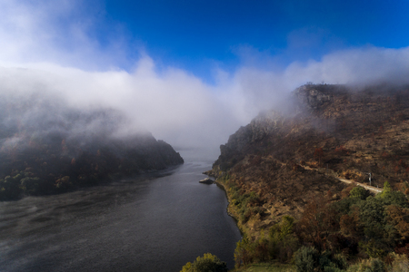 Aerial view of the Portas de Rodao covered in mist in the Tagus River, Portugal; Concept for travel in Portugal Stock Photo