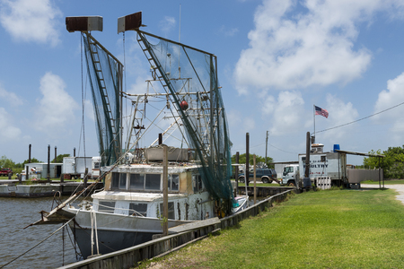 Lake Charles, Louisiana- June 15, 2014: Old shrimp trawler in a port in the banks of Lake Charles in the State of Louisiana, USA Editorial