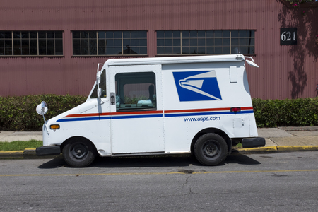 New Orleans, Louisiana - June 17, 2014: United States Postal Service (USPS) truck parked in a street of the city of New Orleans in Louisiana, USA.