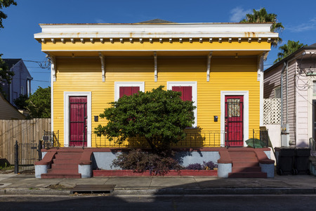 The facade of a traditional colorful house in the Marigny neighborhood in the city of New Orleans, Louisiana, USA Stock Photo