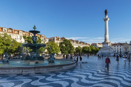 Lisbon, Portugal - October 22, 2017: View of the Rossio Square with tourists walking by, in the pombaline downtown of the city of Lisbon, Portugal
