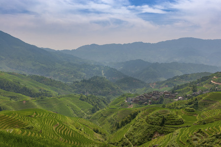 View of the Longsheng Rice Terraces near the of the Dazhai village in the province of Guangxi, in China; Concept for travel in China and beutiful and serene landscape