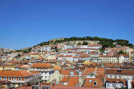 Beautiful view of the city of Lisbon, with the skyline and the Sao Jorge Castle; Concept for travel in Lisbon