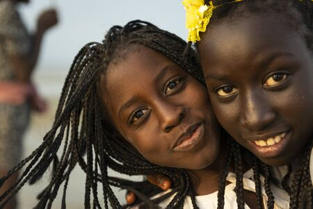 Orango Island, Guinea-Bissau - February 2, 2018:  Portrait of two beautiful young girls at the beach inthe island of Orango.
