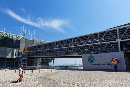 Lisbon, Portugal - June 23, 2018: Couple of tourists arriving at the Oceanario de Lisboa at the Nations Park (Parque das Nações) in the city of Lisbon, in Portugal.