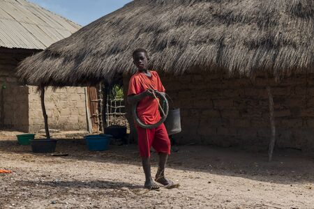 Orango Island, Guinea-Bissau - February 3, 2018:  Boy in front of his home at the village of Eticoga in the island of Orango.